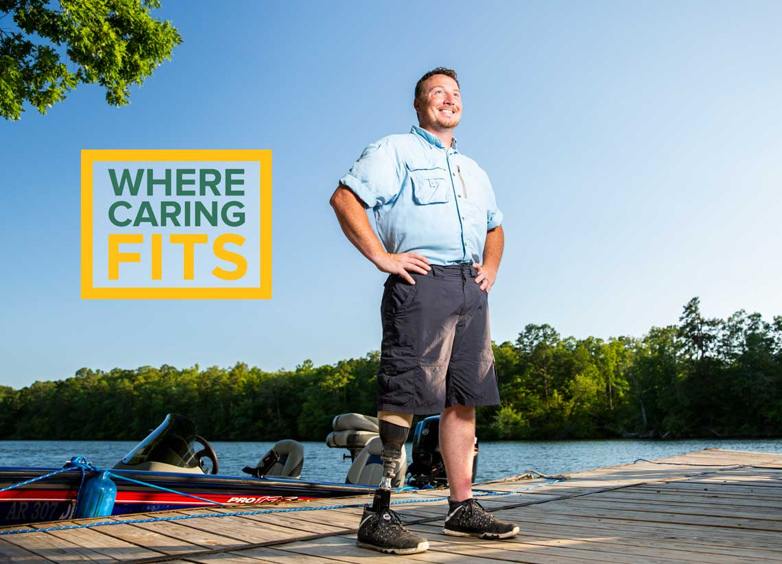 Meet Leland photo of him on his dock next to his boat with a prosthetic leg